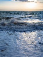 sundown and surf at Dead Sea in winter evening