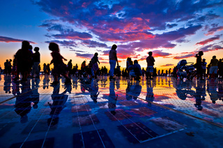 People silhouette on colorful sunset in Zadar