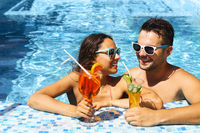Young couple are relaxing in swimming pool