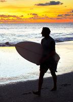Surfer at sunset. Bali island