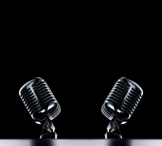 two Retro Mic's stage background in black with space for text