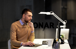man with computer working late at night office