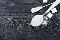 Sugar white in spoon on black board top