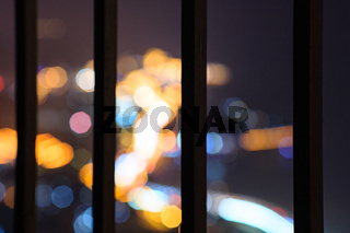 Balustrade with blur street lamp background at night