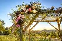 Jewish traditions wedding ceremony. Wedding canopy chuppah or huppah close up on the flowers