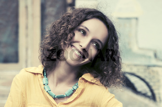 Happy young fashion woman with curly hairs outdoor