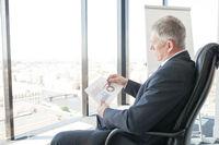 Businessman looking at diagrams