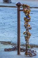 Padlocks on a pole in the street