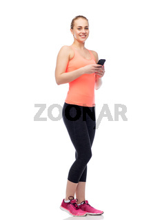 happy smiling sportive young woman with smartphone