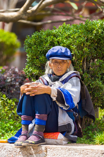 Lijiang Traditional Dressed Naxi Woman Sitting