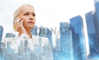 serious businesswoman with smartphone in city