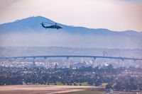 Summer in the San Diego. San Diego Skyline and Military Choppers on the Sky over Coronado Bridge