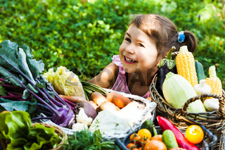 Lovely girl plays with vegetables