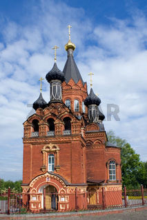 Red church with black cupolas in Bryansk