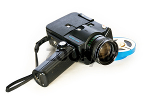 Super 8 movie camera and developed film.