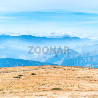 Mountains landscape with field of grass
