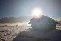 sunshine over wooden hut in Alps