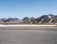 asphalt road on snow area plateau