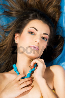 beautiful woman with blue beads