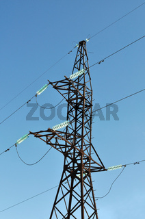 Mast of high voltage electric line on blue sky background