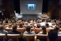 Speaker giving presentation on health care conference.