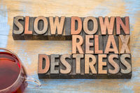 slow down, relax, destress word abstract in wood type