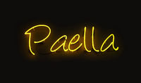 Close up PAELLA yellow neon light sign over black
