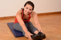 Portrait of sport woman streching legs