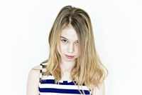 Girl with blond long hair and big eyes in striped clothes