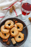 Italian wine donuts and a glass of red wine.