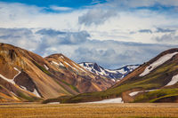 On the mountains are snow fields and glaciers