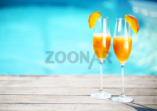 Champagne glasses with peach Bellini cocktail