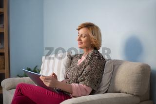 Grandmother sitting on sofa