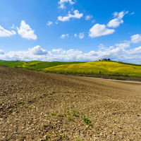 Plowed fields, pastures and farmhouse