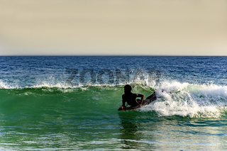 Bodyboarder in Ipanema at afternoon