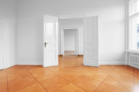 renovated empty apartment  with double wing door and historic parquet floor
