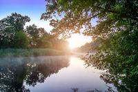 Morning fog on calm river
