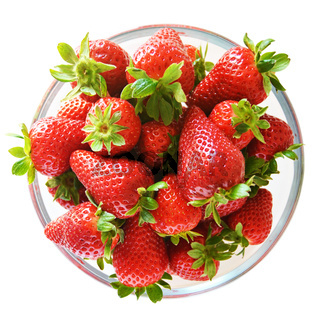 Glass bowl full of strawberries viewed from top