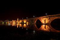 Bridge crossing the Rio Lima at night