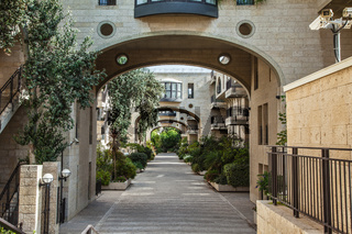 Elegant arched passageway between buildings
