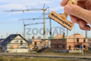 Wohnungsbau markiert auf Holzstempel