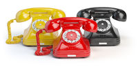 Group of  vintage telephones of differents colors isolated on white background.