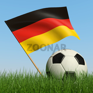 Soccer ball in the grass and the flag of Germany against the blue sky. 3d