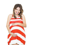 Pretty pregnant woman indoors on white background