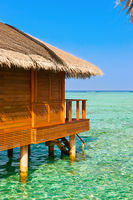 Bungalows on tropical Maldives island