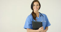 Smiling young female physician smiles at camera