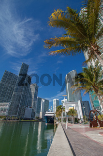 Miami Downtown River Cityscape Along the Brickell Area. Wide Angle Shot with Palms, Skyscrapers and Blue Sky
