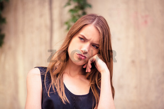 Beautiful young woman with unhappy face.