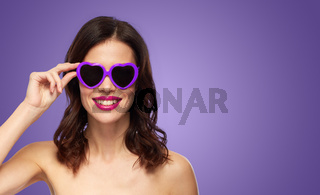 woman with pink lipstick and heart shaped shades