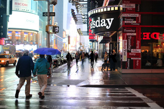 Time Square at night in the rain